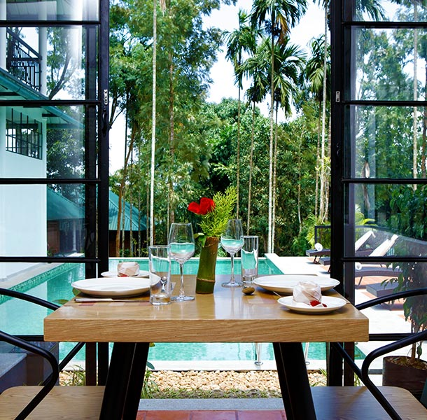 Restaurant, at our hotel in Wayanad where you can savor in your delicacies overlooking the swimming pool