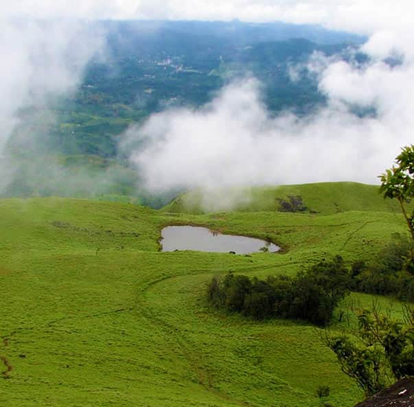 Visit Chembra Peak, while you stay at our hotel near Chembra Peak